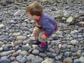 Child Exploring Stones
