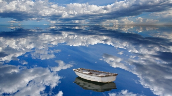 Boat and clouds reflecting on ocean, Bar Harbor, Maine